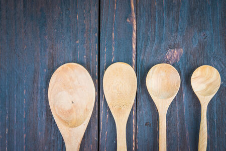 wooden spoon: Wooden spoon on wooden background - old style picture process Stock Photo