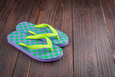 swimming shoes: Slipper on wooden background - vintage effect style pictures Stock Photo