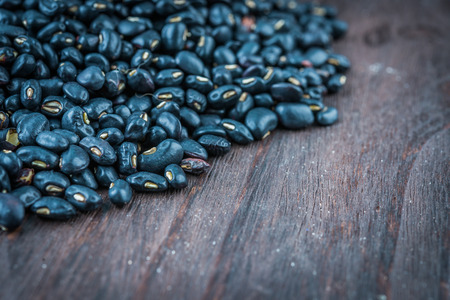 turtle bean: Black beans on wooden background - vintage effect style pictures