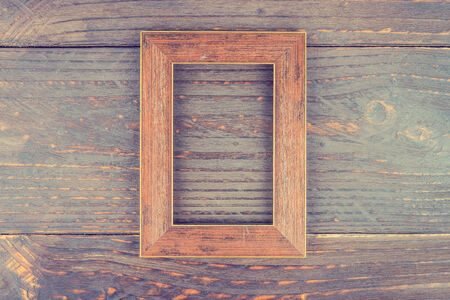 gold picture frame: Photo frame on wooden background - vintage style effect picture