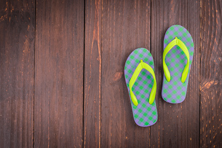 swim shoes: Slipper on wooden background - vintage effect style pictures Stock Photo