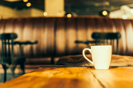 mug: Latte Coffee cup in coffee shop - Vintage Retro effect style pictures Stock Photo