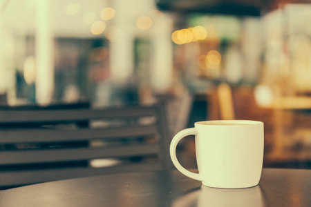 Coffee cup in coffee shop cafe - vintage effect style pictures