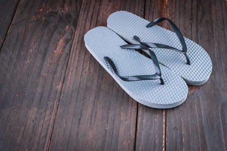 swimming shoes: Slipper on wooden background - vintage effect style picture Stock Photo