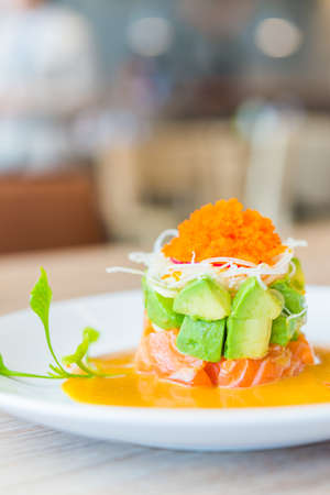 Tartar salmon with avocado salad photo