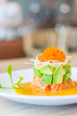 Tartar salmon with avocado salad photo