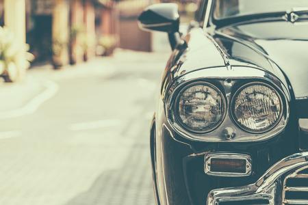 évjárat: Fényszórólámpa vintage klasszikus autó - vintage stílusú képeket hatása Stock fotó