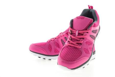 zapato: Rosa Zapatillas de deporte aisladas en el fondo blanco