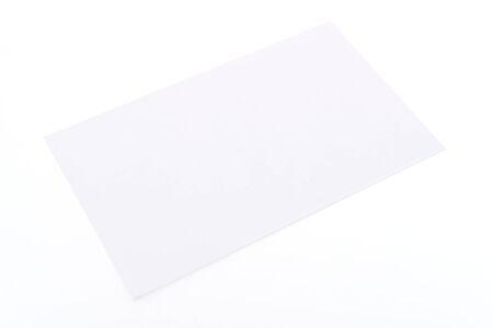 notecard: Blank white card isolated on white background Stock Photo