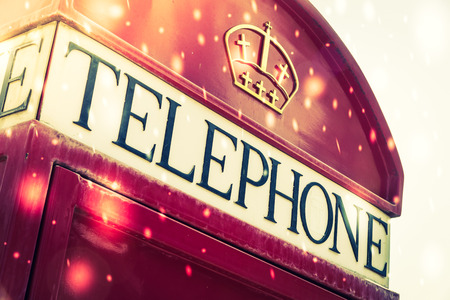 Winter red box telephone - vintage and snow effect processing photo