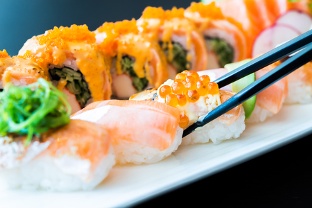 raw food: Salmon sushi roll - japanese food Stock Photo