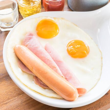 morning breakfast: Morning breakfast with egg , sausage , and ham - soft focus point Stock Photo