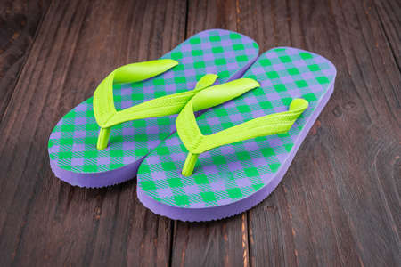 swimming shoes: Slippers on wooden background