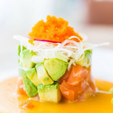 Tartar salmon with avocado salad - japanese food style photo