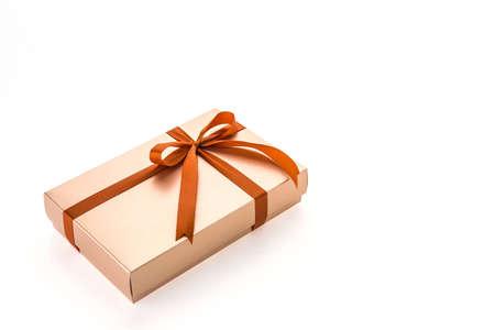 gold gift box: Christmas gold gift box isolated on white background Stock Photo