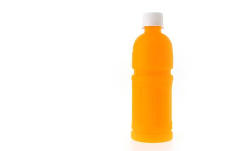 Orange juice bottle isolated on white background photo