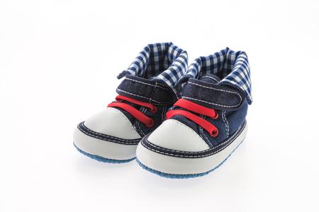 zapato: Zapatos de bebé aislados en el fondo blanco Foto de archivo