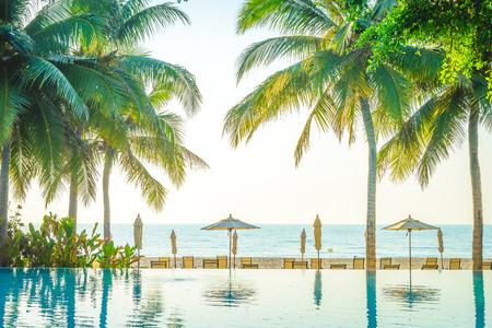 resort: Hotel resort pool on sunrise time - vintage filter and sunflare effect