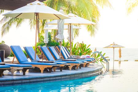 pools: Hotel resort pool on sunrise time - vintage filter and sunflare effect