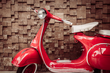 vintage power: Red vintage motorcycle - vintage filter Stock Photo