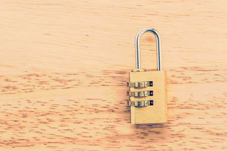 pad lock: Key pad lock on wooden background process vintage style picture