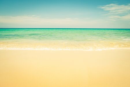 Tropical summer beach and sea wave on blue sky background - vintage filter effect