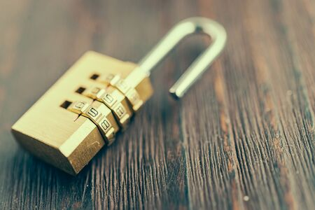 pad lock: Close up pad lock on wooden background - vintage effect style pictures Stock Photo