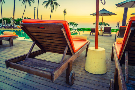 el sheikh: Twilight time Sunset umbrella deck chair pool - vintage filter effect