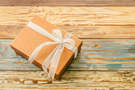 gift box: Gift box on wooden background - vintage effect Stock Photo