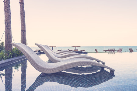 sea resort: Resort pool with umbrella and chair - vintage filter effect Stock Photo