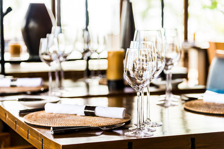 restaurant: Selectiv soft focus on Wine glass on dining table in restaurant Stock Photo