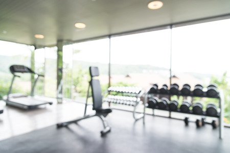 gym room: Abstract blur fitness gym background Stock Photo
