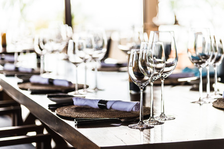 restaurant setting: Selectiv soft focus on Wine glass on dining table in restaurant Stock Photo