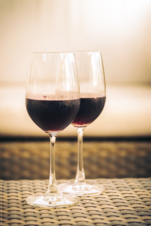drinks on bar: Red Wine glass for dinner - vintage filter