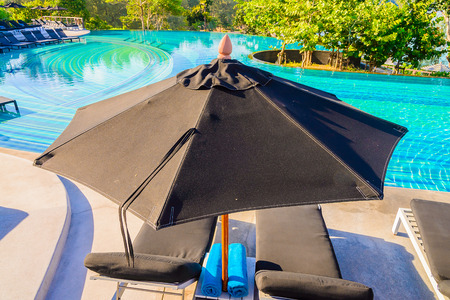 Umbrella pool chair on roof top photo
