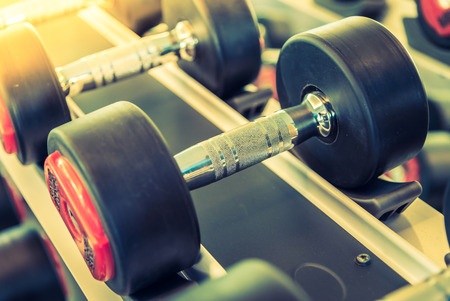 gym equipment: Dumbbell selective focus point - vintage filter and sun flare effect