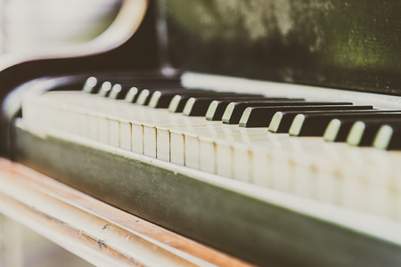 piano closeup: Selective focus point Piano keys - vintage filter