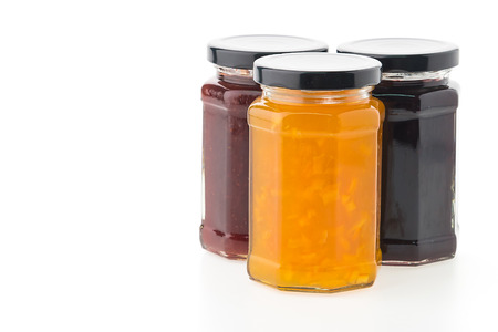 Jam jar bottles isolated on white background photo