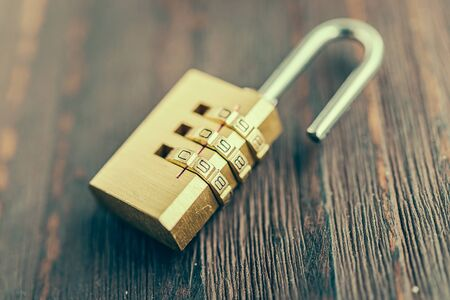 pad lock: Close up pad lock on wooden background