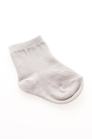 Baby socks isolated on white background photo