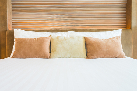 wooden bed: Bedroom pillow with lamp beside bed