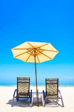 beach paradise: Umbrella beach chair on beautiful tropical beach