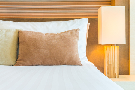 bedroom bed: Bedroom pillow with lamp beside bed