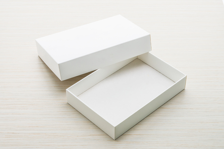 caja blanca: White box mock up on wooden background Foto de archivo