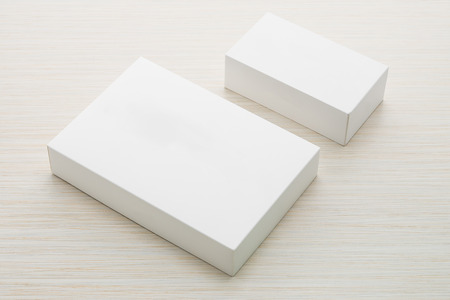 product packaging: White box mock up on wooden background Stock Photo