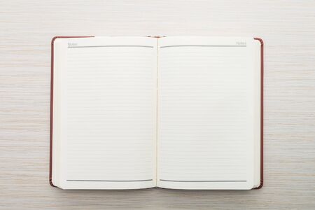 notebook: Notebook paper on wooden background