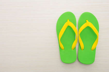 to flop: Flip flop on wooden background Stock Photo