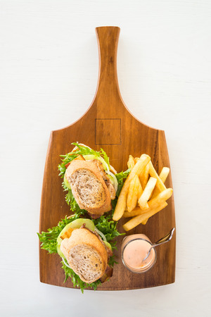 lunch tray: Chicken Sandwich and french fries on wood tray Stock Photo
