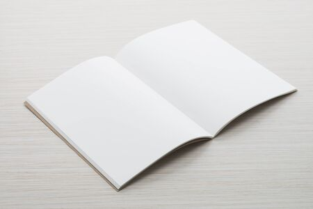 open magazine: Blank paper mock up on wood background