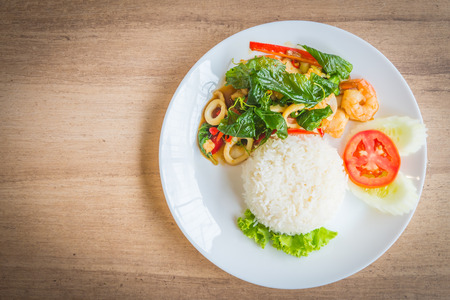 Spicy fried basil leaf with seafood and rice - soft focus point Reklamní fotografie - 42279168
